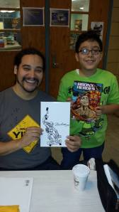 Comic book pro, Ray Felix and budding young artist.